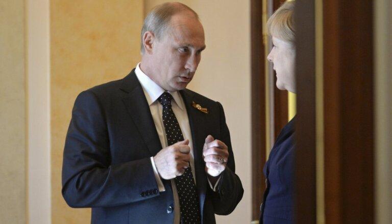 Меркель обсудила с Путиным Украину и Сирию