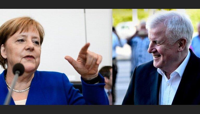 Merkele un Zēhofers tiekas krīzes sarunās