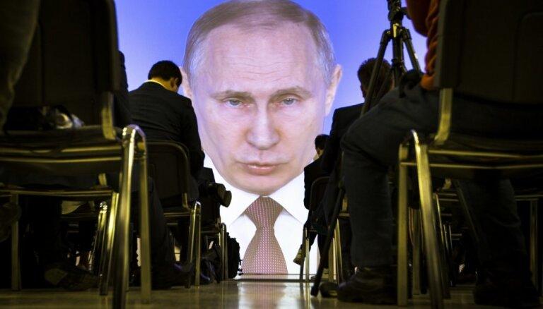 Putins apsūdzības par iejaukšanos ASV prezidenta vēlēšanās nosauc par 'kliegšanu un vaimanāšanu'
