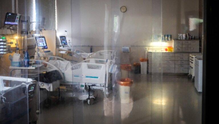Slimnīcas jaunajā Covid-19 vilnī: par miljoniem iepirktas tehnoloģijas, bet trūkst darbaroku