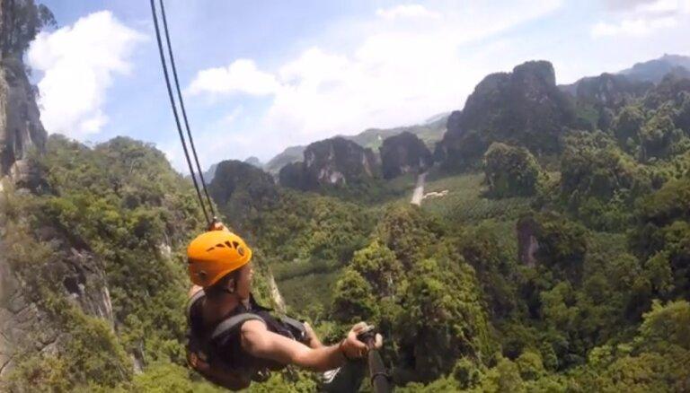 Ekstrēmas šūpoles Taizemē, kas ierīkotas 55 metru augstumā